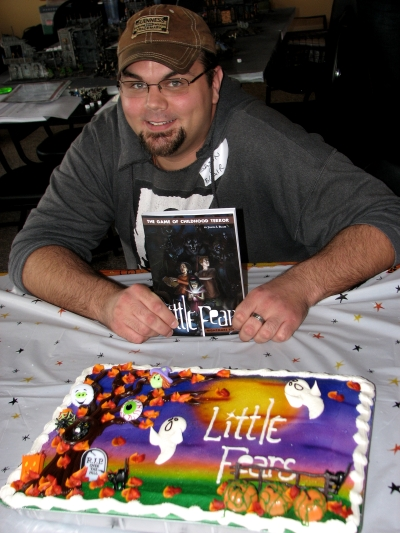 Jason L Blair with Little Fears Sheet Cake | Photo by Monica Valentinelli